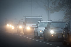 Queue of cars in fog Royalty Free Stock Photography