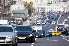 Queue of cars on the turn. During the rush hour Royalty Free Stock Photography