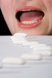 Queue of chewing gums heading to open mouth Royalty Free Stock Photo
