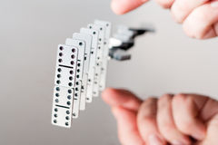 A queue of falling dominoes Royalty Free Stock Photos