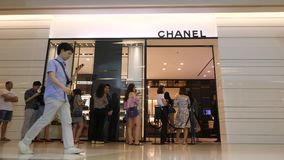 Queue People in front of Chanel Clothing Brand Luxury Fashion Shop in Siam Paragon. 4K. Bangkok, Thailand - 12 NOV 2017.