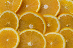 Queue of slices oranges Stock Photography