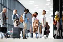 Queue to check in in airport stock images