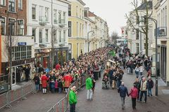 Queue of visitors to the Dickens Festival in Deventer in The Net. Deventer, Netherlands – December 18, 2016: Queue of visitors to the Dickens Festival in Royalty Free Stock Photo