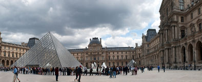 Queue of visitors to the pyramid in Louvre Stock Photo