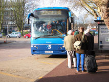 Queueing for a bus. Stock Photo