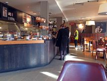 Queueing inside a coffee shop. coffeehouse. Royalty Free Stock Photography
