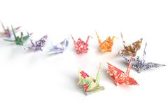 Queuing. A queue of colourful origami birds on a white background Royalty Free Stock Photo