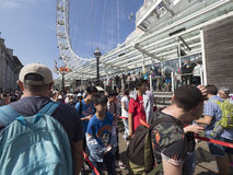 Queuing for the London Eye, London. The London Eye is the most popular attraction of the UK and the tallest Ferris Wheel in Europe at 135 meters 443 feet Stock Images