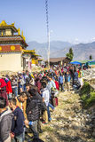 Queuing at the temple. At the bumchu festival, Tashiding, Sikkim, Buddhist believers, men and women, are queuing in two lines to get into the temple. In the Royalty Free Stock Photos