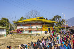 Queuing at the temple. At the bumchu festival, Tashiding, Sikkim, Buddhist believers, men and women,  are queuing in two lines to get into the temple. In the Royalty Free Stock Photography