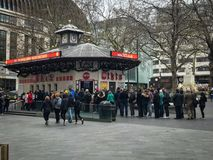 Queuing for tickets, London,. LONDON, UK. 27/01/2018. Customers queuing at the TKTS official London Theatre booth in Leicester Square, London in January 2018 royalty free stock photography