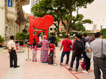 Queuing up of taking photograph. Kuala Lumpur, Malaysia -  April 22, 2017: Tourists queuing up for posing with the ` I love KL` sign at the entrance of the Kuala Royalty Free Stock Photography