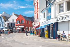 Landscapes and architectures of Brittany. Quiberon, France - August 9, 2017: The houses and stores overlooking the Port Maria harbor Royalty Free Stock Photo