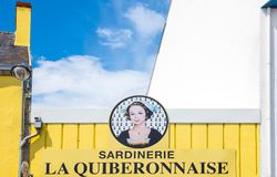 Landscapes and architectures of Brittany. Quiberon, France - August 9, 2017: The sign of a fish store overlooking the Port Maria harbor Royalty Free Stock Photos