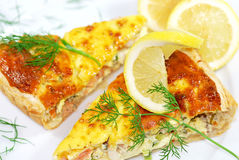 Quiche. Home-made salmon and prawn quiche slices, decorated with lemon slices and dill Royalty Free Stock Photos