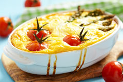 Quiche with asparagus and tomato Royalty Free Stock Images