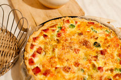 Quiche with broccoli. Hot quiche with broccoli and bacon Royalty Free Stock Photography