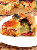 Quiche with broccoli and ham Stock Images