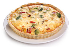 Quiche with broccoli and vegetables on a white plate. Royalty Free Stock Photos