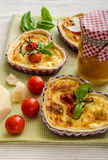 Quiche with cheese and cherry tomatoes Stock Image