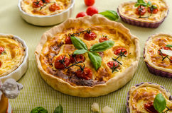 Quiche with cheese and cherry tomatoes Royalty Free Stock Photography
