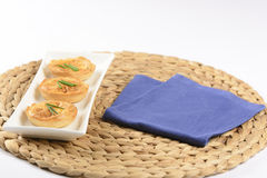 Quiche with cheese and chive. Little quiches on a white dish stock photography