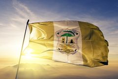 Quiche Department of Guatemala flag textile cloth fabric waving on the top sunrise mist fog. Beautiful royalty free stock images