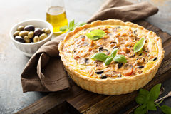 Quiche with eggplant, chicken and olives Stock Image