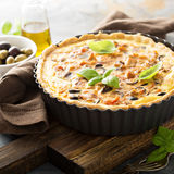 Quiche with eggplant, chicken and olives Royalty Free Stock Images