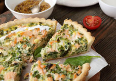 Quiche with fish and spinach royalty free stock image