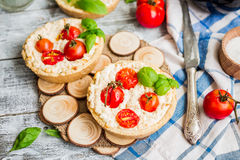 Quiche with goat cheese and cherry tomatoes, vegetarian food Stock Photography