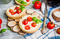 Quiche with goat cheese and cherry tomatoes, vegetarian food Stock Photos