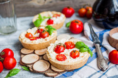 Quiche with goat cheese and cherry tomatoes, vegetarian food Royalty Free Stock Image