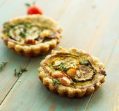 Quiche with grilled zucchini, smoked cheese and thyme Stock Photos