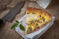 Quiche with ham and sage Stock Photography