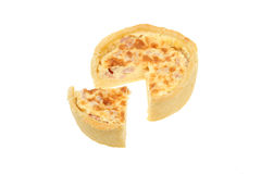 Quiche lorraine. With a slice cut out stock images