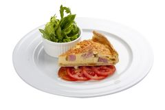 Quiche lorraine cake with greens royalty free stock photography