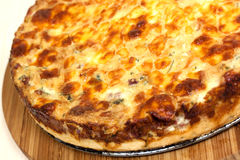 Quiche Lorraine on the cutting board Royalty Free Stock Images