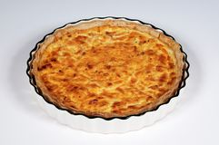 Quiche Lorraine in fluted flan dish. Royalty Free Stock Image