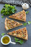 Quiche Lorraine and lamb's lettuce. Piece of quiche lorraine and fresh lamb's lettuce Royalty Free Stock Image