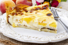 Quiche Lorraine with peaches. Quiche Lorraine Summer festive and party dessert Royalty Free Stock Photos