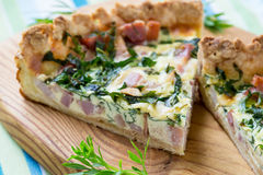 Quiche lorraine, pie with a smoked bacon, cheese and spinach Royalty Free Stock Image
