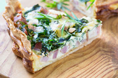 Quiche lorraine, pie with a smoked bacon, cheese and spinach Stock Photo