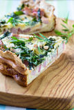 Quiche lorraine, pie with a smoked bacon, cheese and spinach Stock Image