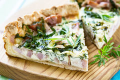 Quiche lorraine, pie with a smoked bacon, cheese and spinach Royalty Free Stock Photography