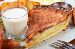 Quiche lorraine slice. A slice of bacon and cheese quiche lorraine on a white plate Stock Photography