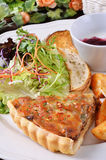 Quiche lorraine slice                                            Salty fried chicken. A slice of quiche lorraine on a white plate Stock Images