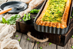 Quiche lorraine with spinach and green onion Stock Photos