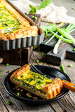 Quiche lorraine with spinach and green onion Royalty Free Stock Images